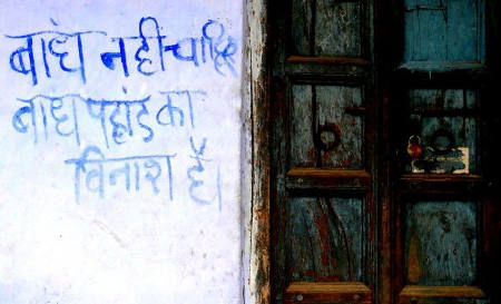 'We don't want dams, dams destroy  mountains' reads a slogan painted on a wall in Uttarakhand (Image Source: GJ Lingaraj)